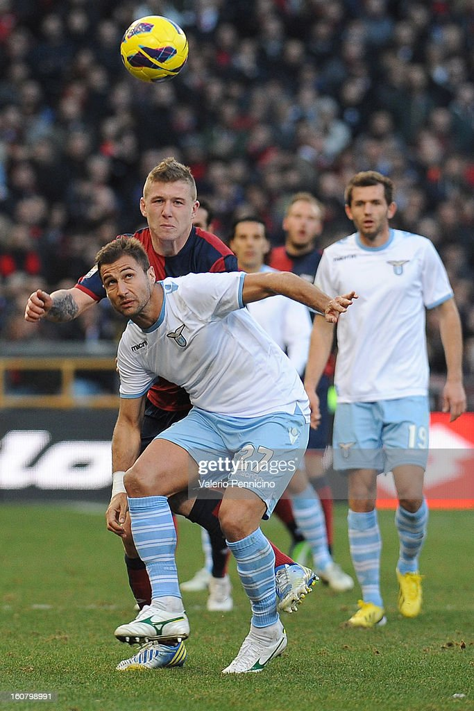 Juray Kucka (R) of Genoa CFC competes with Lorik Cana of S.S. Lazio during the Serie A match between Genoa CFC and SS Lazio at Stadio Luigi Ferraris on February 3, 2013 in Genoa, Italy.