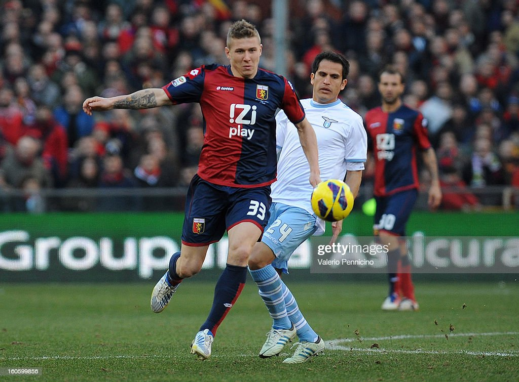 Juray Kucka (L) of Genoa CFC in action against Cristian Ledesma of S.S. Lazio during the Serie A match between Genoa CFC and SS Lazio at Stadio Luigi Ferraris on February 3, 2013 in Genoa, Italy.