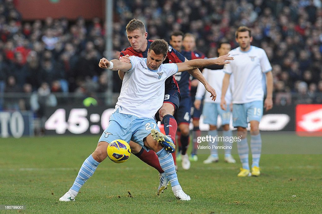Juray Kucka (L) of Genoa CFC tackles <a gi-track='captionPersonalityLinkClicked' href=/galleries/search?phrase=Lorik+Cana&family=editorial&specificpeople=662499 ng-click='$event.stopPropagation()'>Lorik Cana</a> of S.S. Lazio during the Serie A match between Genoa CFC and SS Lazio at Stadio Luigi Ferraris on February 3, 2013 in Genoa, Italy.