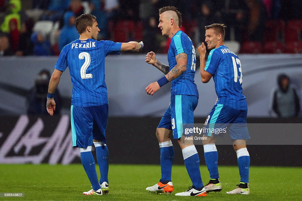 Juray Kucka (C) of Slovakia celebrates his team's third goal with team mates <a gi-track='captionPersonalityLinkClicked' href=/galleries/search?phrase=Peter+Pekarik&family=editorial&specificpeople=5577121 ng-click='$event.stopPropagation()'>Peter Pekarik</a> and Patrik Hrosovsky during the international friendly match between Germany and Slovakia at WWK-Arena on May 29, 2016 in Augsburg, Germany.