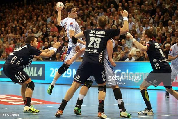 Jure Dolenec of Montpellier scores during the Velux EHF Champions League round of 16 second leg match between SG Flensburg Handewitt and Montpellier...