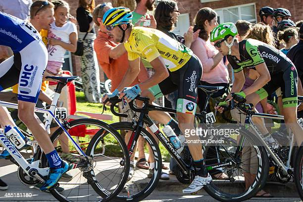 Jure Kocjan of Team SmartStop and Alex Howes of the CannondaleGarmin Pro Cycling Team get cheered by fans during stage 5 of the Tour of Utah on...