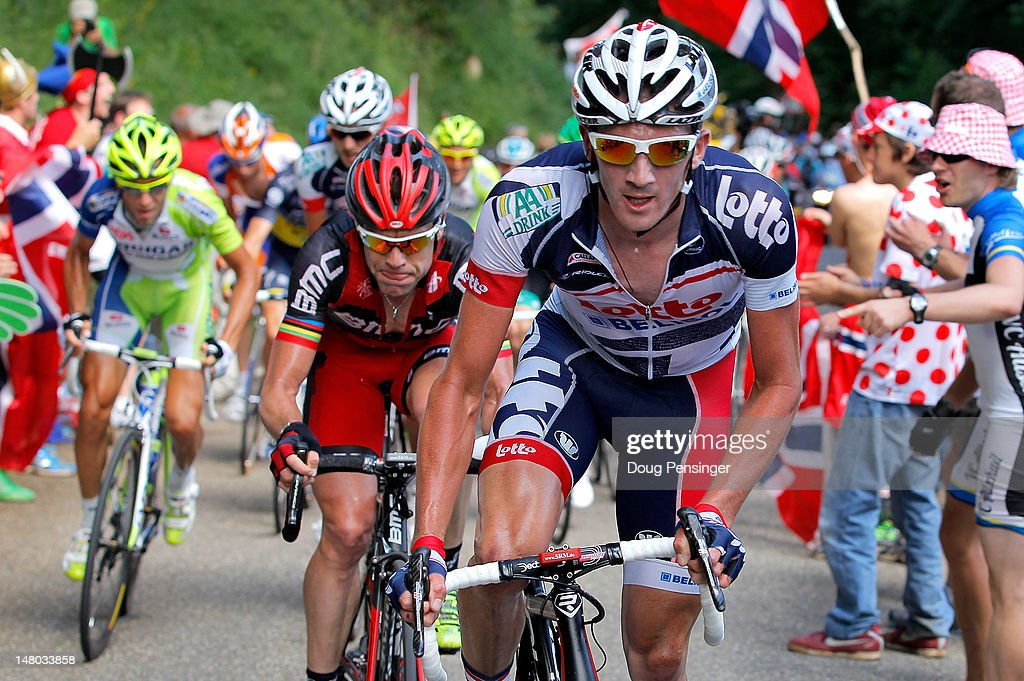 Jurge Van Den Broeck (R) of Belgium riding for Lotto-Belisol attacks the group of the yellow jersey and is followed by <a gi-track='captionPersonalityLinkClicked' href=/galleries/search?phrase=Cadel+Evans&family=editorial&specificpeople=661127 ng-click='$event.stopPropagation()'>Cadel Evans</a> (C) of Australia riding for BMC Racing and <a gi-track='captionPersonalityLinkClicked' href=/galleries/search?phrase=Vincenzo+Nibali&family=editorial&specificpeople=770634 ng-click='$event.stopPropagation()'>Vincenzo Nibali</a> (L) of Italy riding for Liquigas-Cannondale on the climb of the Col de la Croix during stage eight of the 2012 Tour de France from Belfort, France to Porrentruy, Switzerland on July 8, 2012 in Saint-Ursanne, Switzerland.