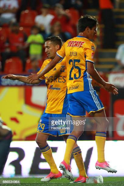 Jurgen Damm of Tigres celebrates with Jesus Dueñas after scoring the second goal of his team during the semi final second leg match between Tijuana...
