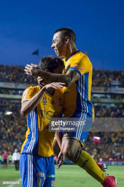 Jurgen Damm of Tigres celebrates with teammate Eduardo Vargas after scoring his team's second goal during the 14th round match between Tigres UANL...