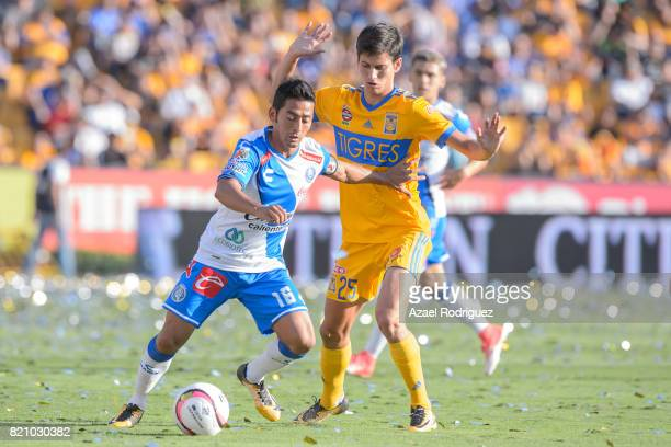 Jurgen Damm of Tigres fights for the ball with Jose Toledo of Puebla during the 1st round match between Tigres UANL and Puebla as part of the Torneo...