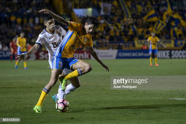 Jurgen Damm of Tigres fights for the ball with Matias Laba of Vancouver Whitecaps during the semifinals first leg match between Tigres UANL and...