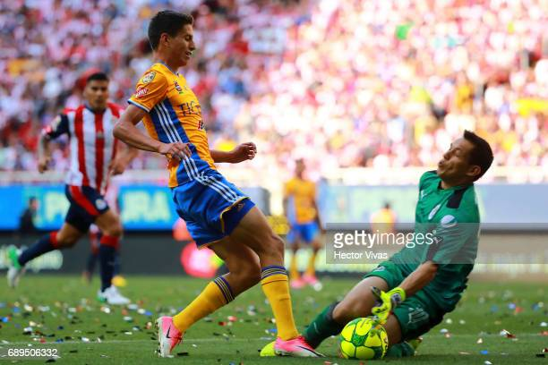 Jurgen Damm of Tigres tries to score against Rodolfo Cota goalkeeper of Chivas during the Final second leg match between Chivas and Tigres UANL as...