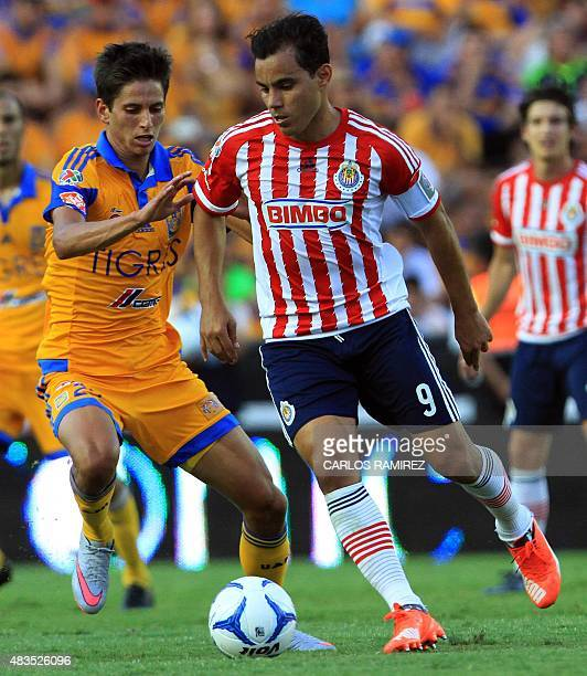 Jurgen Damm of Tigres vies for the ball with Omar Bravo of Chivas during their Mexican Apertura football tournament in Monterrey Nuevo Leon State...