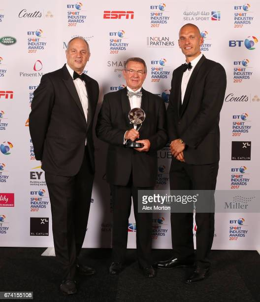 Jurgen Grobler poses with the Coutts Lifetime Achievement award and Sir Steve Redgrave and Mo Sbihi during the BT Sport Industry Awards 2017 at...