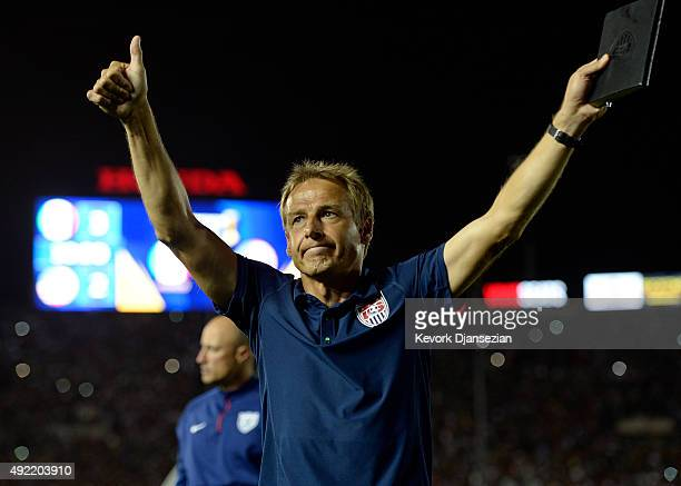 Jurgen Klinsmann head coach of the United States reacts as he leaves the Rose Bowl stadium after Mexico defeated the United States 32 after extra...