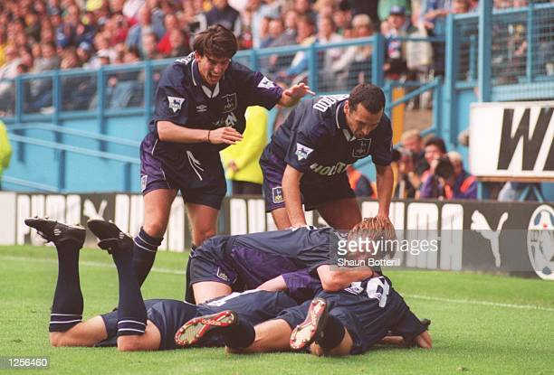 Jurgen Klinsmann of Tottenham is mobbed by teammates after scoring a goal during the FA Carling Premier League match between Sheffield Wednesday and...