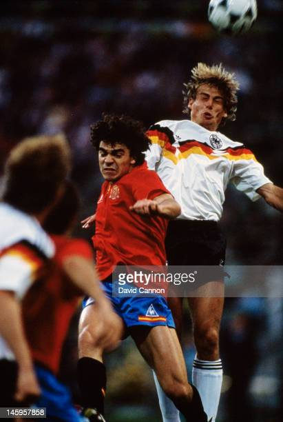 Jurgen Klinsmann of West Germany rises above Manuel Sanchis of Spain to head the ball during the UEFA European Championships 1988 Group 1 match...