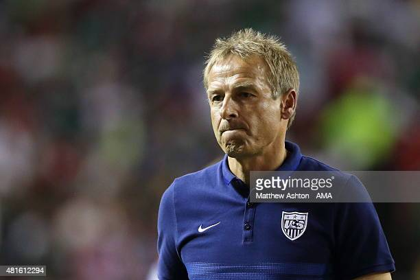 Jurgen Klinsmann the head coach / manager of United States of America walks off the field after losing in the 2015 CONCACAF Gold Cup Semifinal...