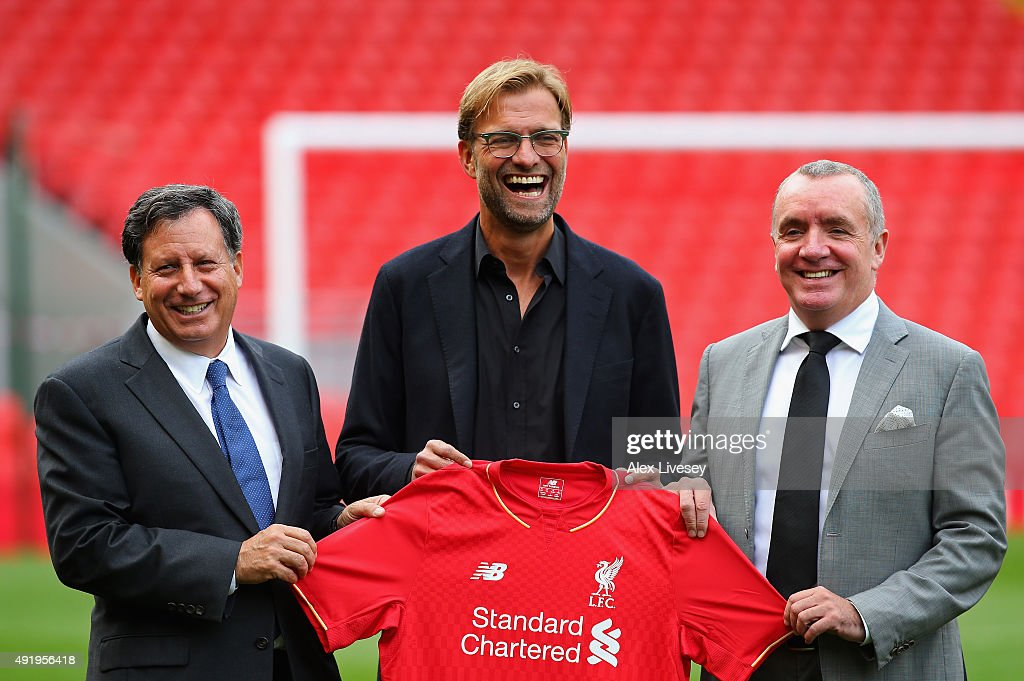 Jurgen Klopp at Anfield is unveiled as the new manager of Liverpool FC as he stands alongside Tom Werner (l) the chairman and Ian Ayre (r) the chief executive during a photocall at Anfield on October 9, 2015 in Liverpool, England.