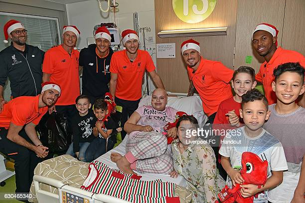 Jurgen Klopp Jordan Henderson Alex Manninger Shamal George Daniel Sturridge Dejan Lovren and Ragnar Klavan of Liverpool at Alder Hey Children's...