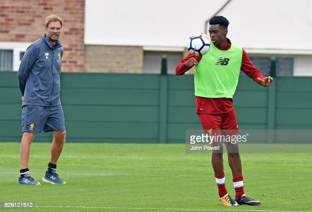Jurgen Klopp looks on at Ovie Ejaria of Liverpool during a training session at Melwood Training Ground on August 10 2017 in Liverpool England