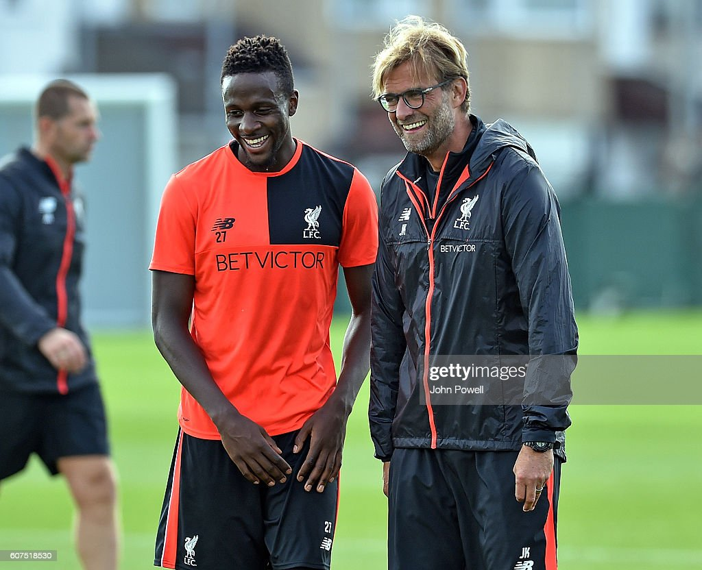 Jurgen Klopp Manager, and Divock Origi of Liverpool during a training session at Melwood Training Ground on September 18, 2016 in Liverpool, England.