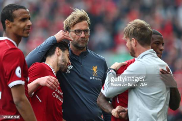 Jurgen Klopp manager / head coach of Liverpool and Adam Lallana of Liverpool celebrate at full time during the Premier League match between Liverpool...