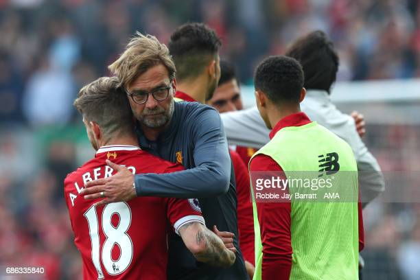 Jurgen Klopp manager / head coach of Liverpool and Alberto Moreno of Liverpool celebrate at full time during the Premier League match between...