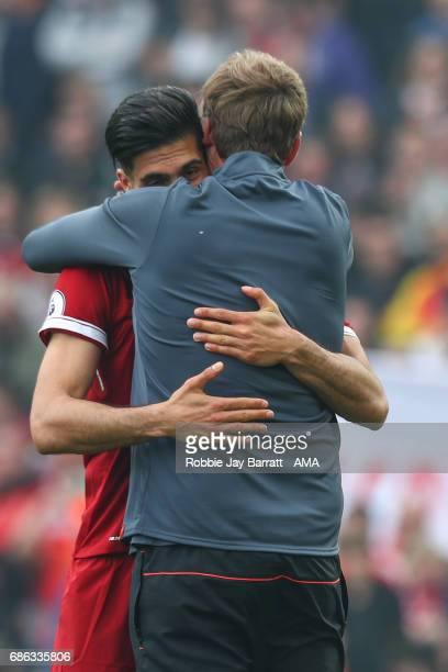 Jurgen Klopp manager / head coach of Liverpool and Emre Can of Liverpool celebrate at full time during the Premier League match between Liverpool and...