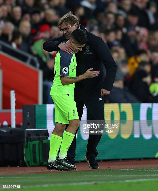 Jurgen Klopp manager / head coach of Liverpool with Philippe Coutinho of Liverpool during the EFL Cup semifinal first leg match between Southampton...