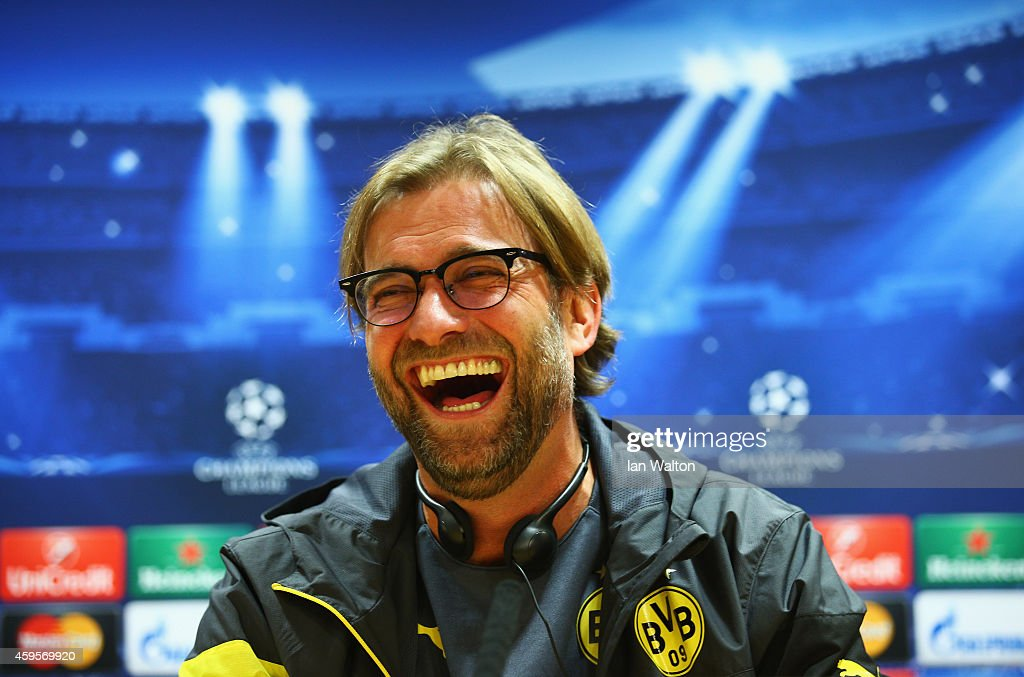 Jurgen Klopp manager of Borussia Dortmund laughs during a Borussia Dortmund press conference, ahead of the UEFA Champions League Group D match against Arsenal, at Emirates Stadium on November 25, 2014 in London, England.