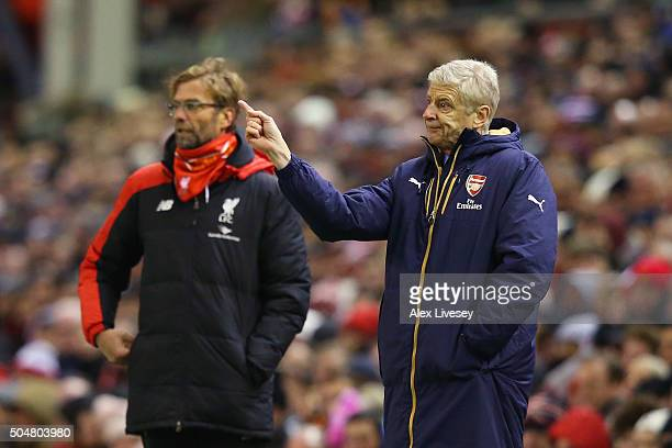 Jurgen Klopp manager of Liverpool and Arsene Wenger Manager of Arsenal look on during the Barclays Premier League match between Liverpool and Arsenal...
