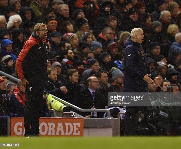 Jurgen Klopp manager of Liverpool and Arsene Wenger manager of Arsenal react during the Barclays Premier League match between Liverpool and Arsenal...