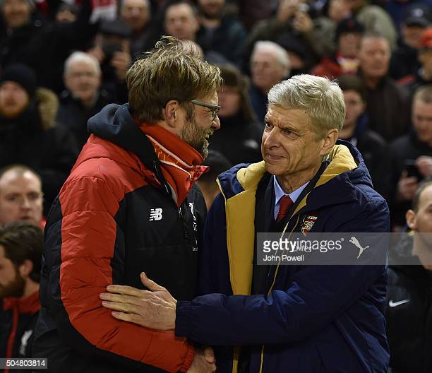 Jurgen Klopp manager of Liverpool and Arsene Wenger manager of Arsenal shake hands before the Barclays Premier League match between Liverpool and...