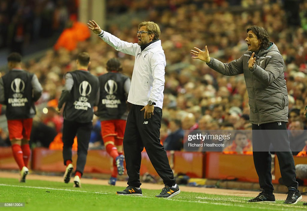 Jurgen Klopp manager of Liverpool and assistant coach Zeljko Buvac (R) shout during the UEFA Europa League semi final second leg match between Liverpool and Villarreal CF at Anfield on May 5, 2016 in Liverpool, England.