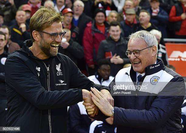 Jurgen Klopp manager of Liverpool and Claudio Ranieri manager of Leicester City share a laugh and shake hands before the Barclays Premier League...