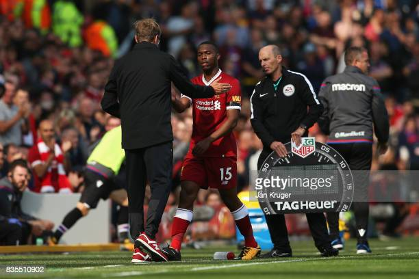 Jurgen Klopp Manager of Liverpool and Daniel Sturridge of Liverpool shake hands after being substituted during the Premier League match between...