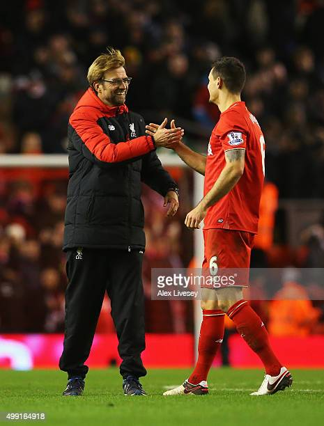 Jurgen Klopp manager of Liverpool and Dejan Lovren of Liverpool shake hands after the Barclays Premier League match between Liverpool and Swansea...