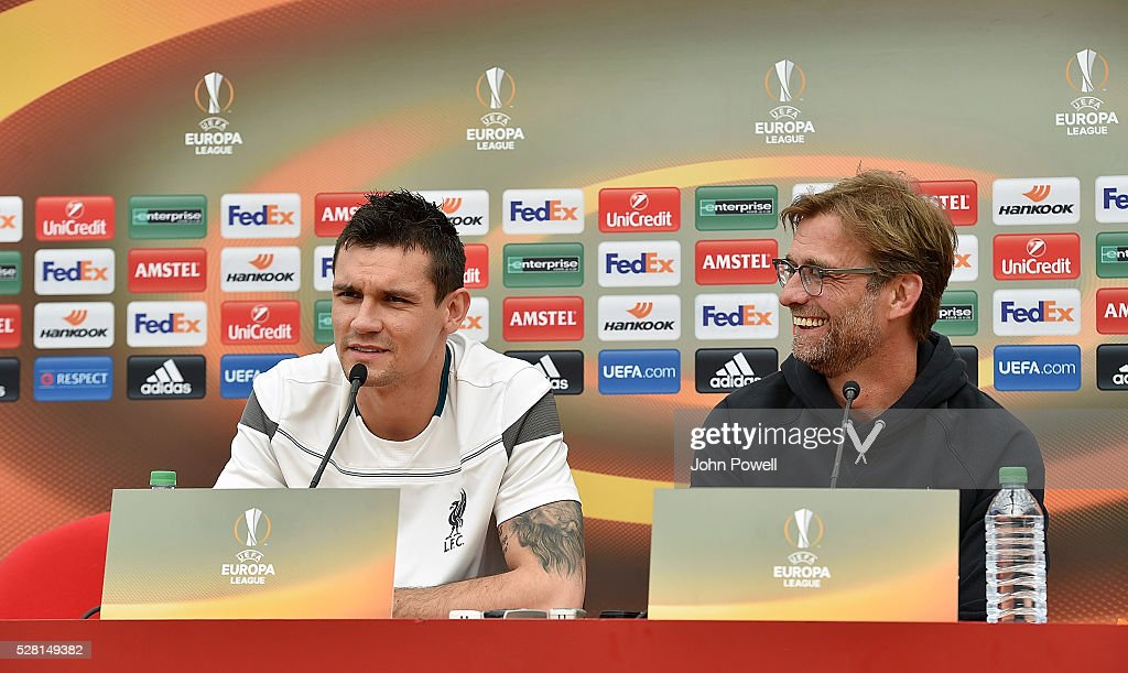 Jurgen Klopp manager of Liverpool and <a gi-track='captionPersonalityLinkClicked' href=/galleries/search?phrase=Dejan+Lovren&family=editorial&specificpeople=5577379 ng-click='$event.stopPropagation()'>Dejan Lovren</a> of Liverpool during the press conference at Melwood Training ground on May 04, 2016 in Liverpool, England.