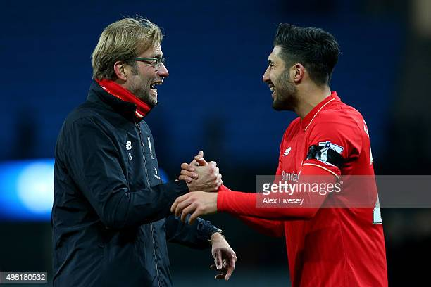 Jurgen Klopp manager of Liverpool and Emre Can celebrate their 41 win in the Barclays Premier League match between Manchester City and Liverpool at...