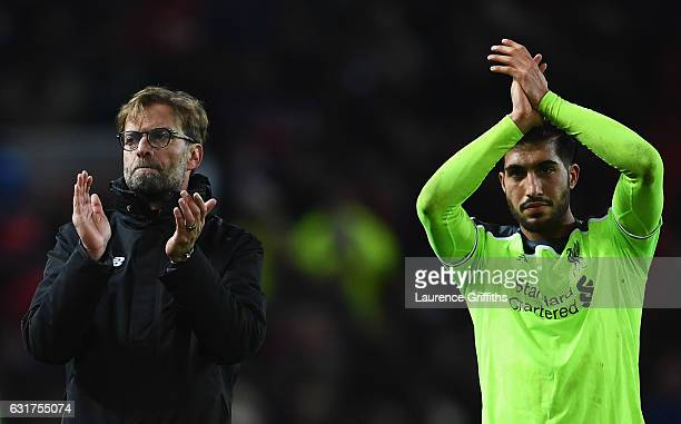 Jurgen Klopp manager of Liverpool and Emre Can of Liverpool applaud the travelling fans after the Premier League match between Manchester United and...