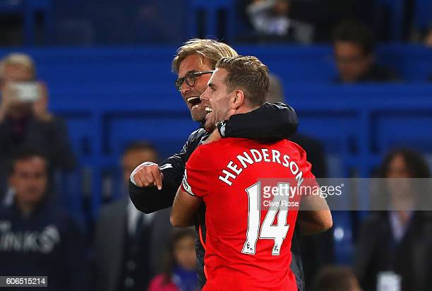 Jurgen Klopp Manager of Liverpool and Jordan Henderson of Liverpool celebrate victory in the Premier League match between Chelsea and Liverpool at...