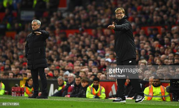 Jurgen Klopp manager of Liverpool and Jose Mourinho manager of Manchester United give instructions during the Premier League match between Manchester...
