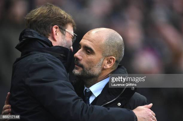 Jurgen Klopp Manager of Liverpool and Josep Guardiola Manager of Manchester City embrace prior to the Premier League match between Manchester City...
