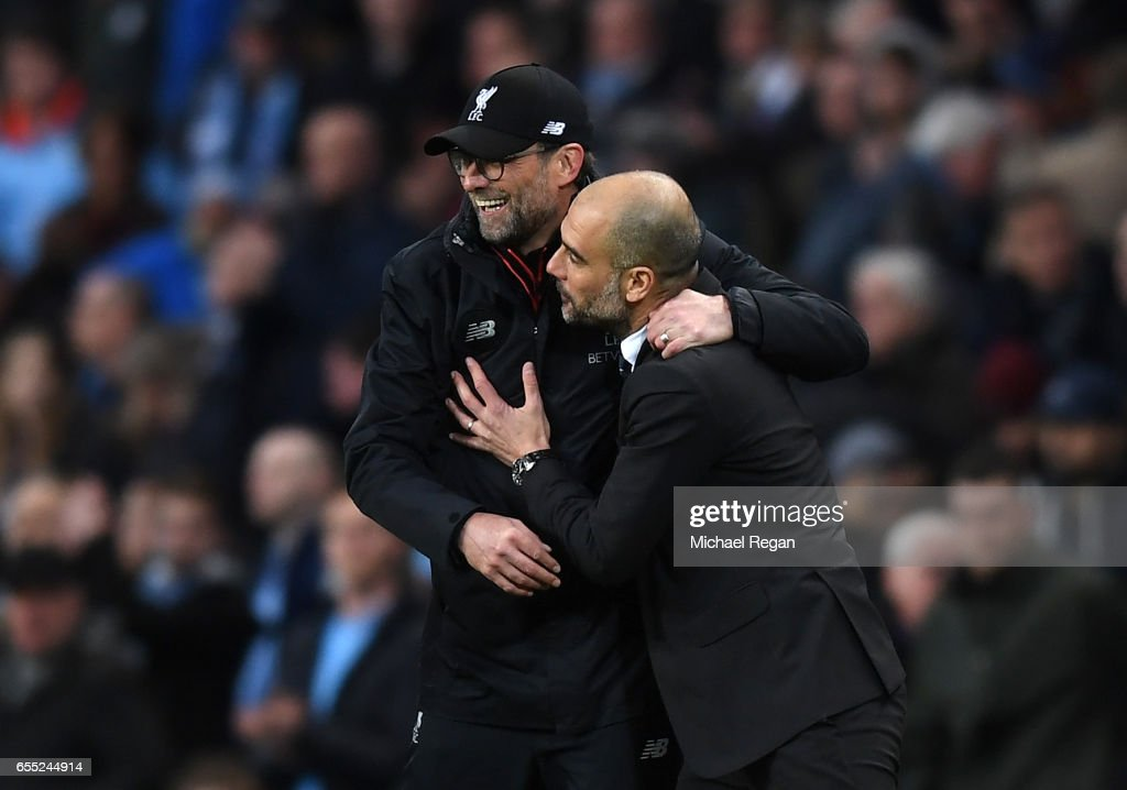 Jurgen Klopp, Manager of Liverpool (L) and Josep Guardiola, Manager of Manchester City (R) embrace after the Premier League match between Manchester City and Liverpool at Etihad Stadium on March 19, 2017 in Manchester, England.