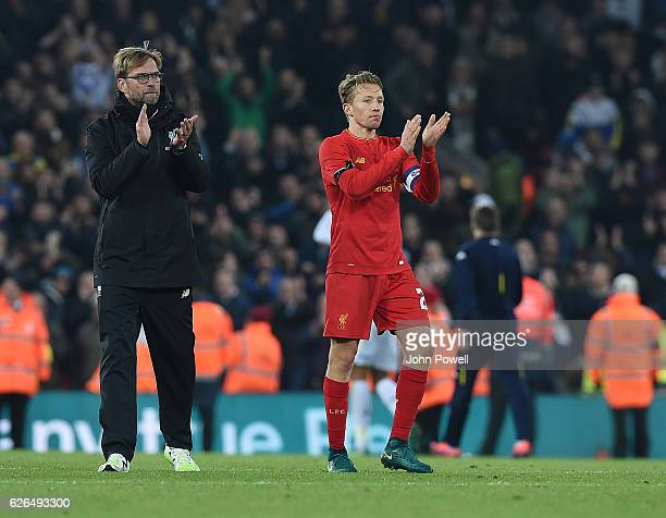 Jurgen Klopp Manager of Liverpool and Lucas applaud at the end of the EFL Cup QuarterFinal match between Liverpool and Leeds United at Anfield on...