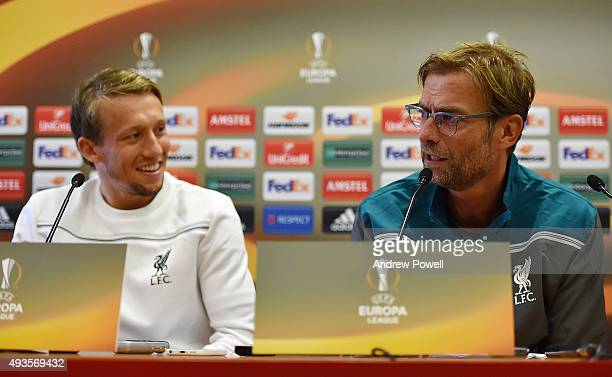 Jurgen Klopp manager of Liverpool and Lucas Leiva during a press conference at Melwood Training Ground on October 21 2015 in Liverpool England