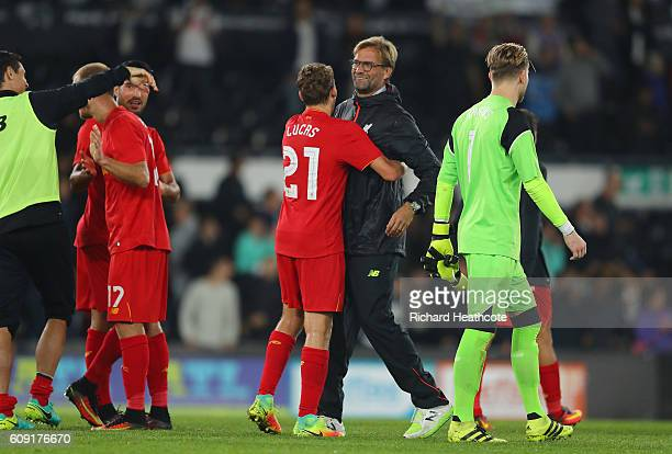 Jurgen Klopp Manager of Liverpool and Lucas Leiva of Liverpool react after the full time whistle during the EFL Cup Third Round match between Derby...
