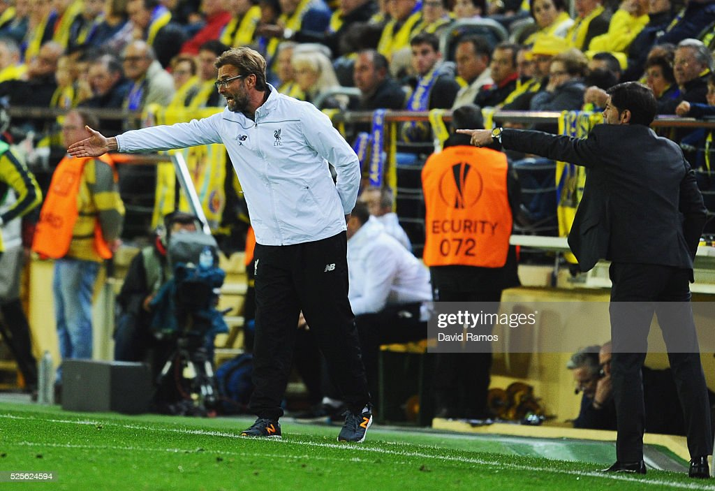 Jurgen Klopp manager of Liverpool and Marcelino Garcia Toral head coach of Villarreal signal from the touchline during the UEFA Europa League semi final first leg match between Villarreal CF and Liverpool at Estadio El Madrigal on April 28, 2016 in Villarreal, Spain.