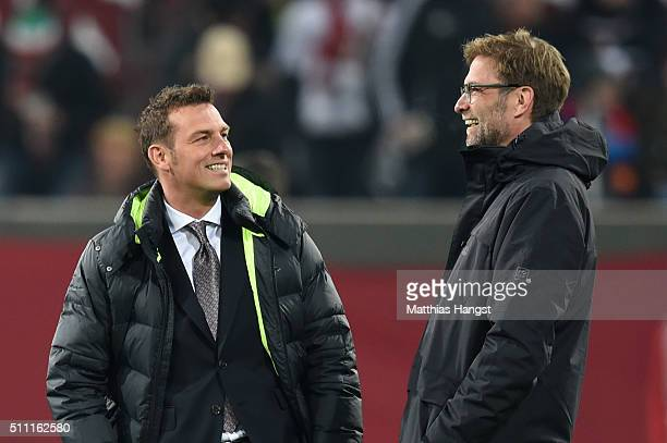 Jurgen Klopp manager of Liverpool and Markus Weinzierl head coach of Augsburg talk prior to the UEFA Europa League round of 32 first leg match...