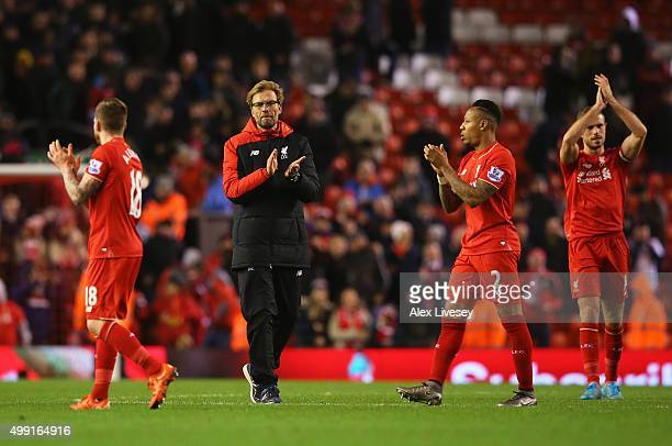 Jurgen Klopp manager of Liverpool and Nathaniel Clyne of Liverpool applaud the crowd after the Barclays Premier League match between Liverpool and...
