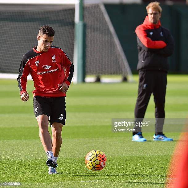 Jurgen Klopp manager of Liverpool and Philippe Coutinho during a training session at Melwood Training Ground on October 30 2015 in Liverpool England