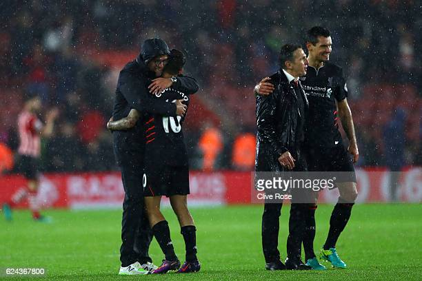 Jurgen Klopp Manager of Liverpool and Philippe Coutinho of Liverpool embrace after the final whistle during the Premier League match between...