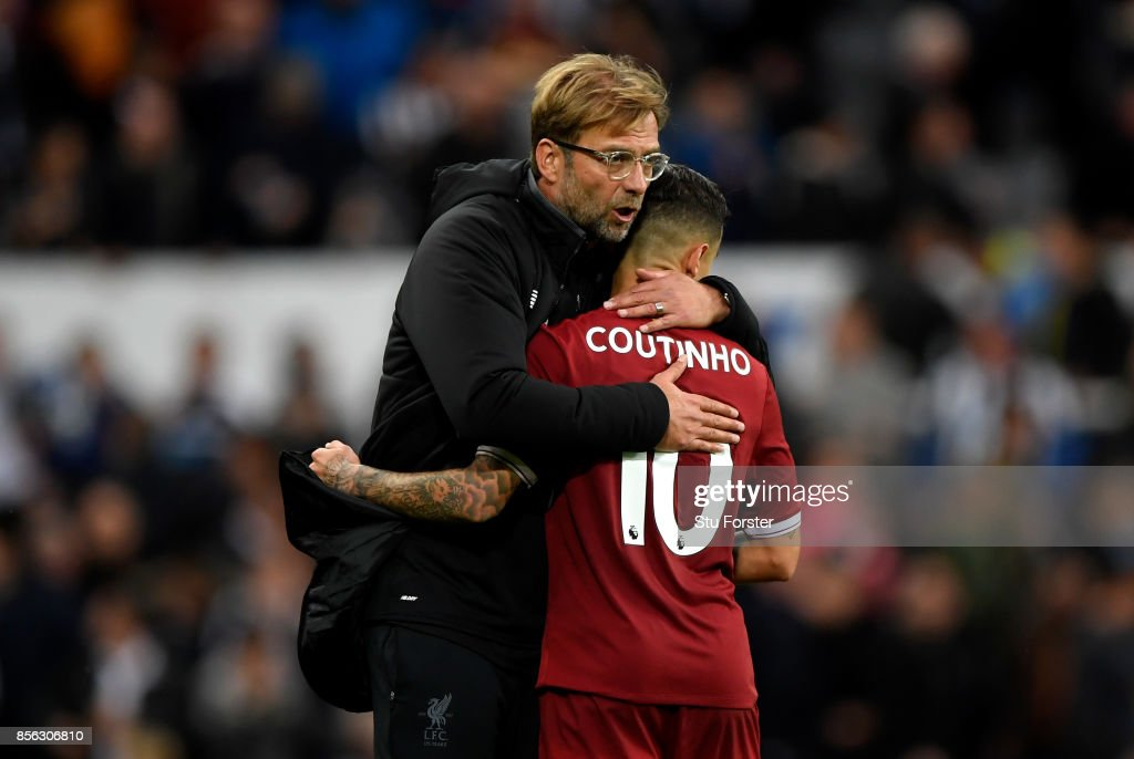 Jurgen Klopp, Manager of Liverpool and Philippe Coutinho of Liverpool embrace after the Premier League match between Newcastle United and Liverpool at St. James Park on October 1, 2017 in Newcastle upon Tyne, England.